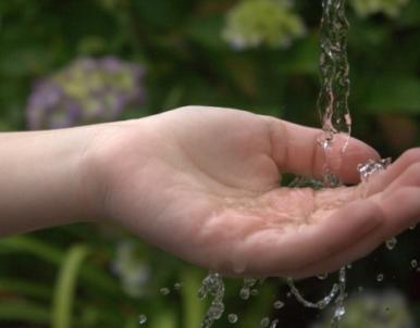 Water over kids hands